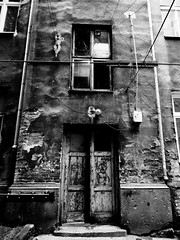 entrance (Daniel*1977) Tags: poverty door old city urban blackandwhite bw white house black building window face contrast plane fix myself town walks pattern geometry daniel gig poor gray hovel shapes evil samsung poland wb surface days want trouble figure area need warsaw shanty ash civic around form bother exit did enter shape 1977 mischief citizen 77 1000 configuration acreage 320 quandary ashy needy necessity rattrap hardship greay superficies figuration indigence kuliski didmyself ccbync daniel1977 tl320 wb1000 gettypoland1 gettycentraleurope