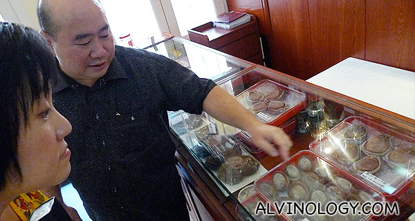 Towkay sharing with Catherine the wide array of abalone selection in his restaurant