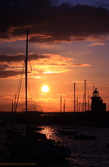 THE HARBOUR (michaeljohnsimages) Tags: ocean voyage camera ireland light sunset shadow sea dublin cloud sun lighthouse inspiration colour reflection art classic nature wet water beauty silhouette clouds canon reflections landscape boats dawn boat photo interesting flickr shine photos yacht picture silouette explore reflect journey observe sail yachts shimmer discover blinkagain bestofblinkwinner