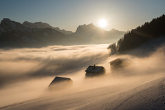 Wrapped in fog (helena678) Tags: mountains sunset sun fog foggy misty farm snow winter light admed switzerland schweiz