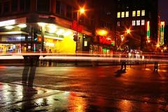Encerclée par la lumière (Sous l'Oeil de Sylvie) Tags: city urban canada car rain lights automobile nightshot montréal lumière pluie reflet québec lighttrails reflexion nuit ville mouvement urbain ruestecatherine longueexposition stecatherinestreet fantomatique photodenuit trainéelumineuse