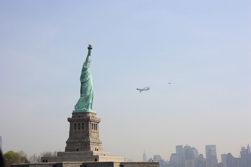 Backup Airforce One plane escorted by fighter jet - taken from ferry near the Statue of Liberty. This is the opposite view to the official photograph