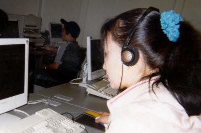 Student wearing headphones at computer