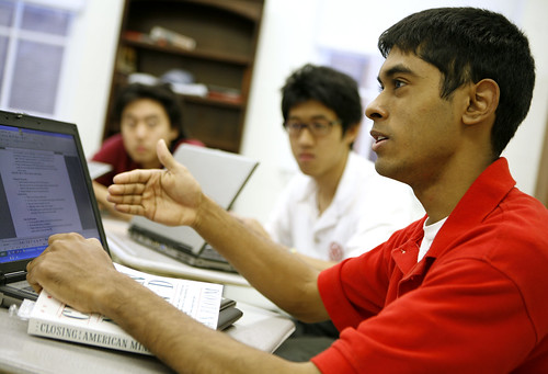 Students at St Andrew's College in Ontario discuss Plato's Republic with laptops open to record notes