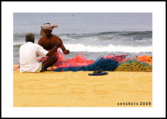 Men @ Work (SenShots / Senthilmani's Photography) Tags: blue red sea people orange india men net beach water colors yellow canon sand colorful waves afternoon fishermen madras chennai 2009 tamilnadu collective southindia altogether chappal canonphotography sigma70300f456dgmacro canoneos1000d canoneosdigitalrebelxs senshots armsenthil senthilmani senshotsphotography
