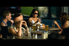 Happy Hour (Dom Cruz) Tags: street girls summer people ontario canada guy beer sunglasses canon movie cafe downtown shadows dof beers bokeh candid guelph streetphotography sunny scene shades patio purse drinks conversations cinematic handbag happyhour goldenhour lateafternoon brewski f20 135l canonef135mmf2lusm 40d canoneos40d