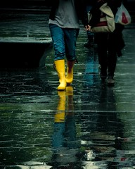 """These Boots Are Made for (Rain) Walking"" (Sion Fullana) Tags: urban newyork reflection rain yellow lumix lluvia rainyday washingtonsquarepark streetphotography reflejo allrightsreserved newyorkers lomostyle rainboots walkingintherain yellowboots urbanshots creativeshots urbannewyork panasonicdmcfz50 colorphotoaward sionfullana thesebootsaremadeforrainwalking"