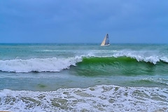 Breaking the waves 1/2 (Fnikos) Tags: sea seascape water boat sailboat people wave waves sky skyline outdoor
