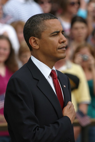 Barack Obama standing with hand over heart during Memorial Day ceremony