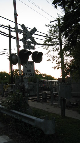 The Maple Avenue CTA railroad crossing at sunset. Wilmette Illinois. Early June 2009.