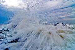 Cloudburst (knowsnotmuch) Tags: water waves tokina1224 splash kovalam donottrythisathome 391 choppyseas explored rigidrocks thesunrisethatneverwasp spraysfromheaven thispicturewasmadebyaprofessionalidiot