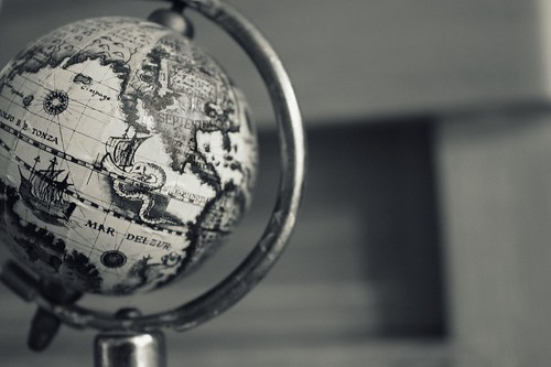 black and white picture of a small old-looking globe.