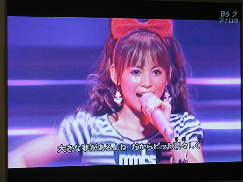This idol was on tv giving a concert. I think she sings a lot of anime songs, because she sang the theme songs from Neon Genesis Evangelion, The Melancholy of Haruhi Suzumiya, Pokemon, Sailor Moon, and many others.