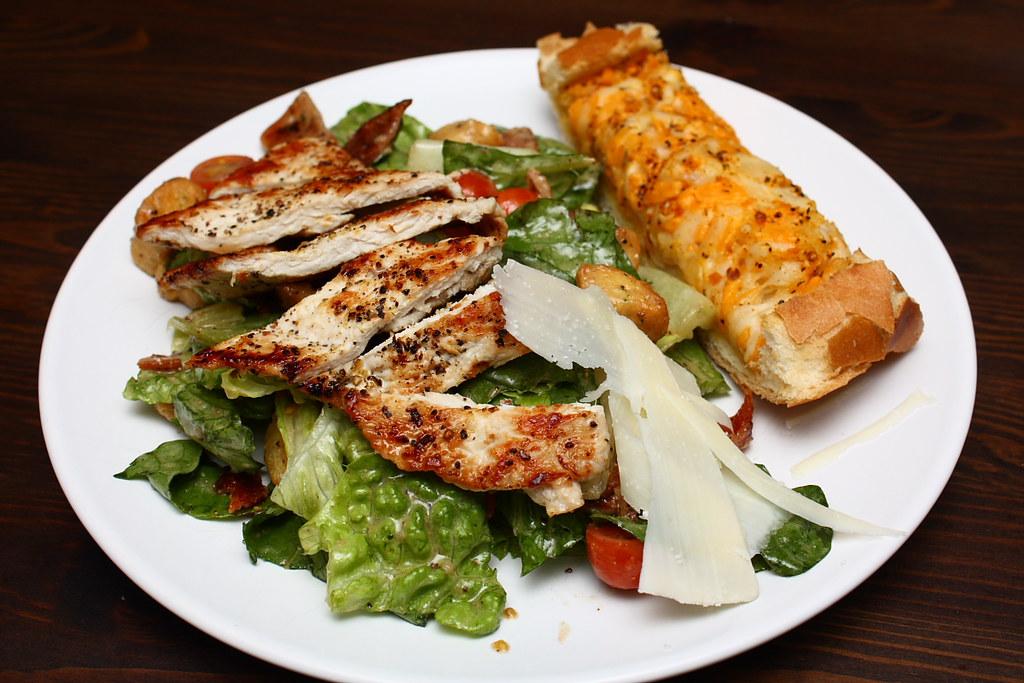 A Club Sandwich / Cesar Salad with fresh parmesan & garlic cheese bread