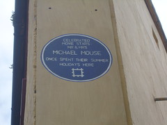 Photo of Mickey Mouse and Minnie Mouse blue plaque