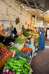 Tangier Indoor Veggie Mart (cwgoodroe) Tags: ocean africa street old city sea summer people sun fish bus colors metal ferry plane children cafe sand ancient colorful doors artistic pentax vibrant muslim poor streetlife mosque arabic panasonic doorway morocco arab friendly moors conservative script casbah vegtable merchants continent merchant christians tangier monger moroccan tanger kasbah cleric sadfaces metaldoors fishmerchant casba casbha dailylifeportrait