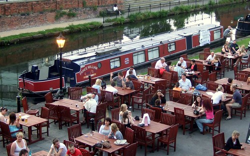 uk summer england people sun beer manchester outdoors evening boat canal wooden pub chairs sale path cider alcohol tables socialising kingsransom