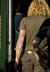 Tattoo (Bart van Dijk (...)) Tags: city red urban netherlands amsterdam tattoo arm nederland streetphotography rood stad brouwerijtij straatfotografie tattouage ijbrewery peopleinamsterdam menseninamsterdam