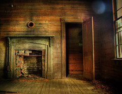 Still Warm (evanleavitt) Tags: county door wood light shadow house texture abandoned home rural ga georgia fireplace open darkness tell decay details atmosphere olympus it historic hearth weathered vs stories laurens could hdr disrepair the e510 photomatix