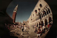 Hey, There's Venezia at the Peephole! (pierofix) Tags: camera venice sky italy 6 building tower film lamp architecture analog square fun toy lomo funny italia afternoon bell outdoor pigeons horizon toycamera wide wideangle 200asa tourists fisheye campanile cielo piazza palazzo venezia settembr