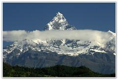 Machhapuchhre by the cloud (songsalways) Tags: nepal canon pokhara fishtail gandaki machhapuchhre syangja canoneos400d sangharsha virginmountain westernnepal