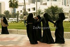 IMG_3239 copy (Zai Aragon) Tags: travel walking women downtown islam group palmtree holdinghands niqab doha qatar traditionalclothing