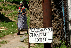 Shangai Hotel (cowyeow) Tags: poverty africa old travel woman strange sign rural hotel weird funny peace shanghai african poor bad wrong faded badsign directions uganda information misspelled funnysign misspell funnyenglish funnyafrica kilembe kilembevalley