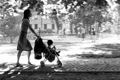 Baby Plays Around (Donato Buccella / sibemolle) Tags: blackandwhite bw motion children play milano streetphotography mamma panning costello santagostino parcosolari canon400d sibemolle vonotter grandissimodiscotuttoilcd osservazionielementarisulcostruire fotografiastradale