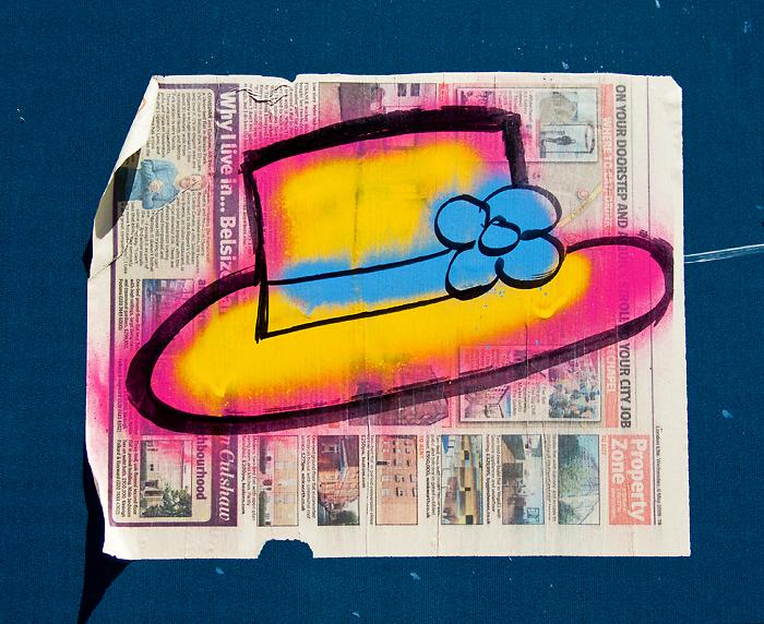 graffiti: summer hat, pink & yellow with a blue ribbon & flower