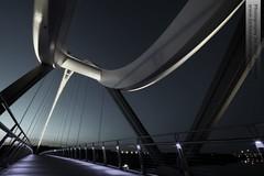 Twisted Metal (~Glen B~) Tags: bridge night river lights suspension steel infinity curves stockton arcs tees thornaby