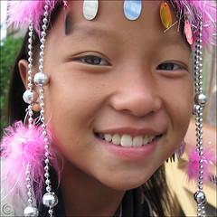 I am Hmong (NaPix -- (Time out)) Tags: family friends party portrait woman black reflection 6x6 smile face festival canon square action vietnam explore jewlery emotions frontpage sapa hmo