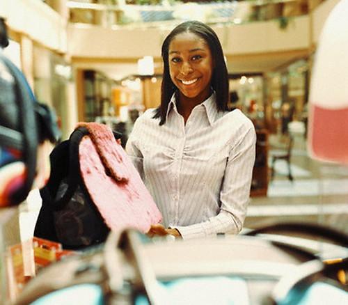 Woman Showing Designer Handbag In Image By Picturenet Blend Images Corbis