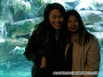 Rachel and Meiyen with the otters in the background