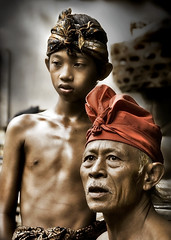 Badung's Pande (Master of Metal) - Father and son (Mio Cade) Tags: travel boy shirtless bali man metal indonesia fire photography iron father son master heat sweat sword kris tradition endurance ubud alloy skill knive pande badung masterofmetal