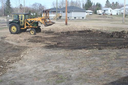 Scraping back the black dirt