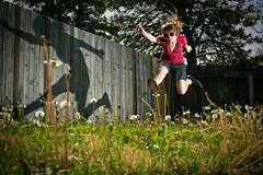 JUMP neighbor's yard (laurenlemon) Tags: shadow summer portrait selfportrait me girl interestingness jump jumping weeds action vans jumpshot jumpology explored strobist canoneos5dmarkii laurenrandolph laurenlemon