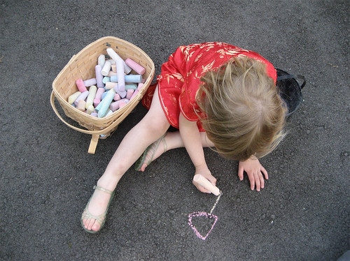 Hannah drawing chalk art at the playground