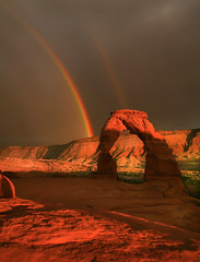 Delicate Arch (elliot23) Tags: park travel light sunset red summer favorite orange usa storm mountains color weather june canon lens landscape evening utah photo amazing rainbow glow arch state exploring arches location double best national 5d delicate 2009 70200mm