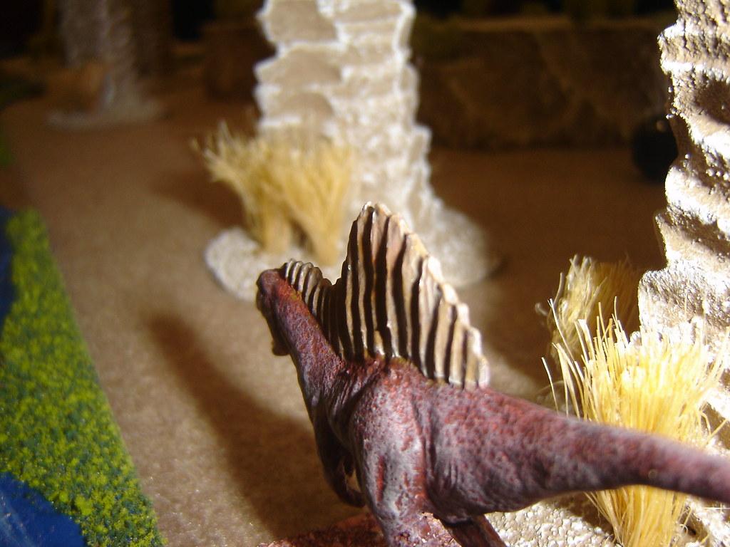 Spinosaurus lurks behind rock formations