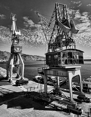 "The toy of my childhood (aerferaer) Tags: sea sky blackandwhite bw mountains blancoynegro car clouds lights luces boat mar spain barco shadows bn cranes textures coche cielo nubes tenerife santacruzdetenerife damn 1001nights inspire distillery canaryislands sombras contrasts texturas seaport montañas islascanarias contrastes gruas backlights contraluces fotoarte blueribbonwinner tokina1224f4 beautifulphoto fineartphotos puertomarítimo betterthangood nikond300 flickrestrellas thebeautifulimagetop goldenart flickrclassique ""clubromanofotografiabw"" 0910150063nef"