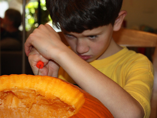 Ross carving pumpkin