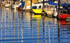 Reflections on Pelican Harbor (Abe K) Tags: california ca color water reflections boats bay harbor nikon san francisco sailing harbour d2x pelican bayarea sail ripples sausalito mywinners flickraward