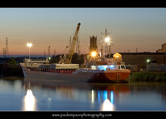 Ship (Paul Simpson Photography) Tags: uk england evening boat ship dusk transport powerlines beltofvenus gunness rivertrent cargoship nighttimephotography northlincolnshire longexposurephotography waterriver northlincs shipphotography june2011 paulsimpsonphotography photosofboats fastsus