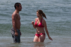 Young healthy couple in swimsuits wade in the ...