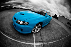 The Blue Shmoo (Steve Koukoulas) Tags: blue storm sports car rain clouds wheels australian fisheye carpark turismo epic coupe thunder v8 holden monaro nostrils vz canonef15mmf28fisheye