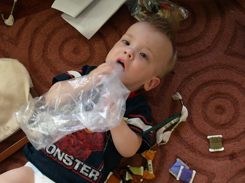 Atti plays with a plastic bag