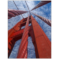 South Tower and Cables (Tony Immoos) Tags: sanfrancisco california lighting bridge blue red sky sunlight tower sunshine clouds wow coast postcard awesome vivid landmark olympus explore goldengatebridge goldengate historical e3 frontpage daytrip 1000views ggb printsavailable happyhours zd sanfranciscocounty 1260mm olympuse3 kitchen428