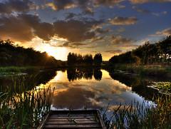 Indian Summer Sunset (Osgoldcross Photography) Tags: trees sunset sun reflection water sunshine clouds reflections evening pier pond raw olympus explore hdr bracketing 3xp photomatix explored rawconversion handheldhdr olympuse420 highspeedbracketing interestingness15on100909 bimonthlywinner normantoncameraclub