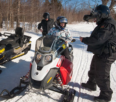 Snowmobile and Conservation Officers doing enforcement on trail system in PEI. (Government of Prince Edward Island) Tags: snow snowmobile conservationofficers sleds trail signage enforcement checkstop