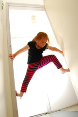 parkour, kids version (rodbotic) Tags: girl kids climb doorway walls parkour payton strobist